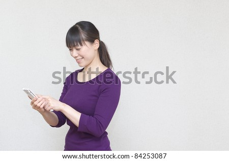 Asian woman using smart phone - stock photo