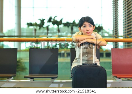 asian woman waiting at airport