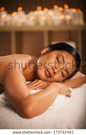 Asian woman waiting for a massage at a spa centre. - stock photo