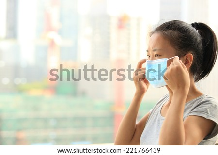 asian woman wear face mask in city  - stock photo