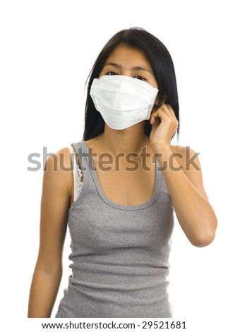 asian woman wearing a face mask - stock photo