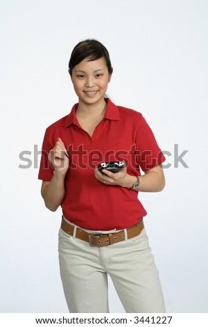 Asian woman wearing a red shirt using a PDA