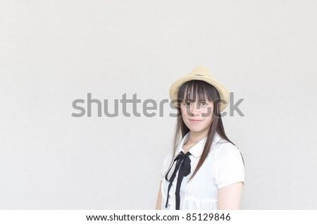 Asian woman wearing a straw hat - stock photo