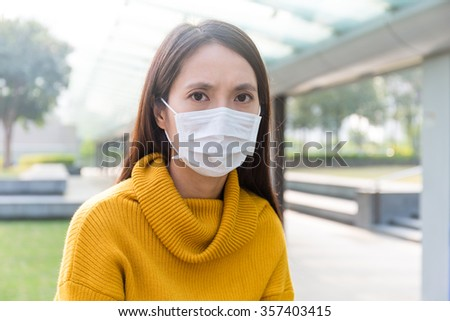 Asian Woman wearing face mask for protect from air pollution - stock photo