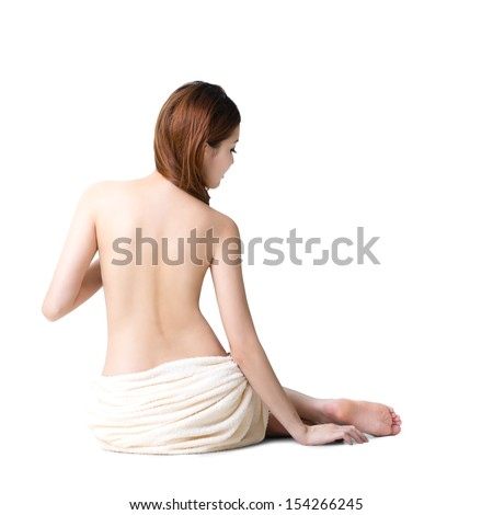 Asian woman wearing towel sitting on the floor back view, Isolated over white with clipping path