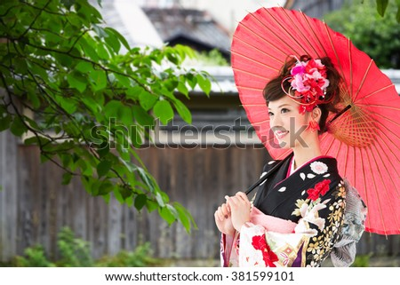 Asian woman wearing traditional japanese kimono - stock photo