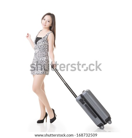 Asian woman with a suitcase, full length portrait isolated on white background. - stock photo