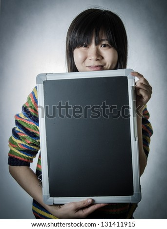 asian woman with blackboard isolated on white - stock photo