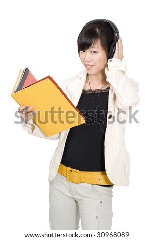 Asian woman with book listening course - stock photo