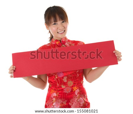 Asian woman with Chinese traditional dress cheongsam holding couplet. Isolated on white background. - stock photo