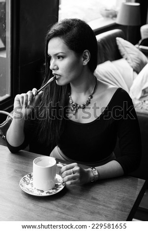 Asian  woman with cup of coffee  - stock photo