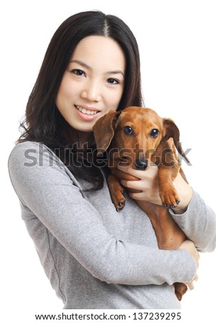 asian woman with dachshund dog - stock photo