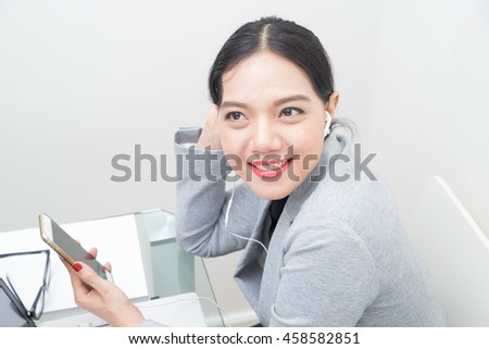 asian woman with earphones,asian woman face