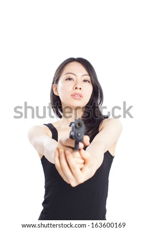 Asian woman with gun isolated on a white background  - stock photo