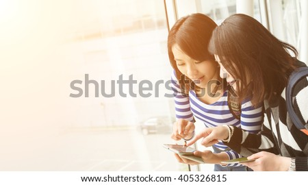 Asian woman with her friend traveling abroad