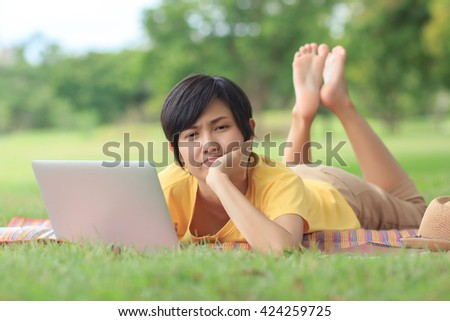 Asian Woman with laptop in park
