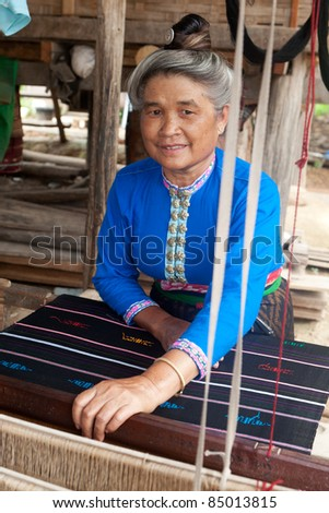 Asian woman with loom - stock photo