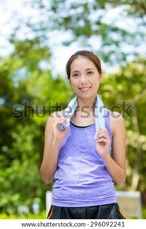 Asian woman with towel on shoulder after doing exercise - stock photo