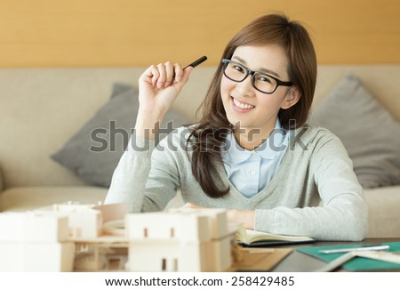 Asian woman working at home - stock photo
