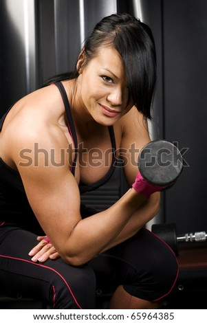 Asian woman working out with weights - stock photo