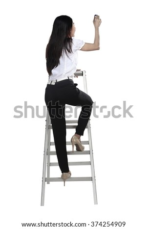 Asian woman write something with pen on the ladder isolated over white background - stock photo