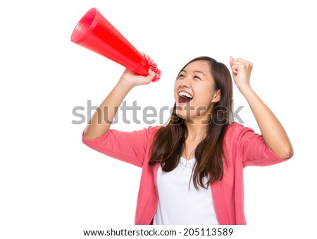 Asian woman yell with loudspeaker - stock photo