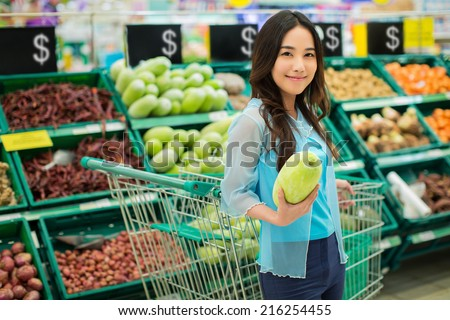 Asian women are buying supermarket vegetables - stock photo