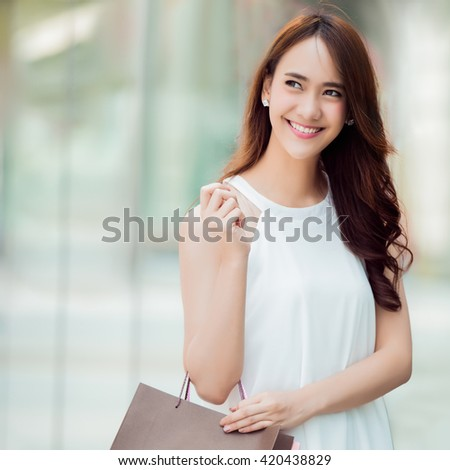 Asian women are shopping department store - stock photo