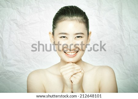 asian women both hands clasp together - stock photo