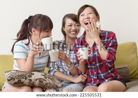 Asian women chat, close-up indoor portrait. - stock photo