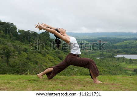 Asian women do Yoga with mountain view, High Lunge - stock photo