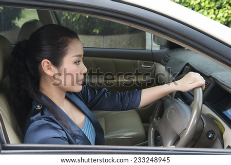 Asian women driving a car - stock photo