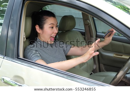 Asian women driving a car with shock