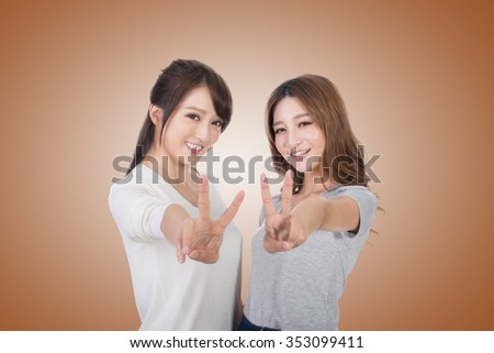 Asian women give you a sign of victory. - stock photo