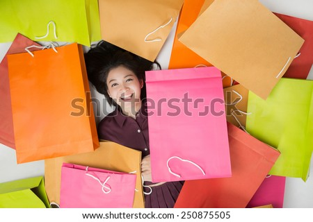 Asian women Happy Just to go shopping There are a lot of bags - stock photo
