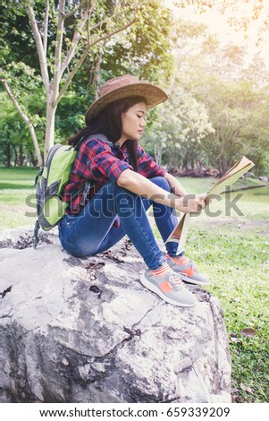 Asian women happy tourist holding map, summer. travel, vacation concept