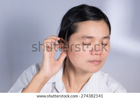 Asian women have an earache. - stock photo