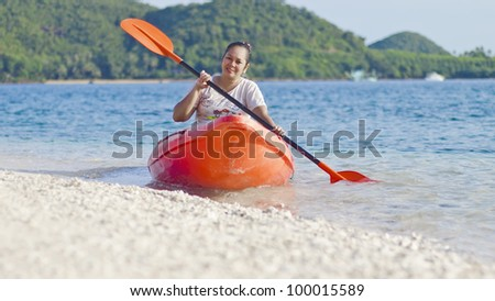 Asian women on a sea kayak