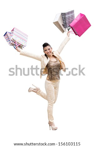 Asian women on holding a lot of shopping bag in Super market ,with clipping path - stock photo