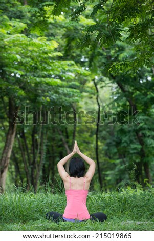 asian women practicing yoga in the garden background