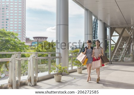 Asian women shopping and walking in the city. - stock photo