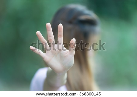 Asian women showing stop hand gesture,  focus hand - stock photo