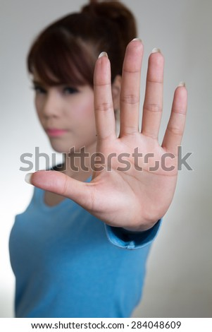 Asian women showing stop hand gesture, selective focus - stock photo