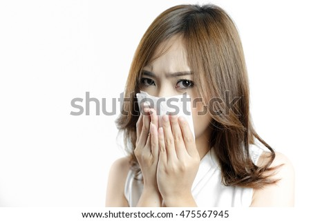 Asian women sneezing in a tissue on white background