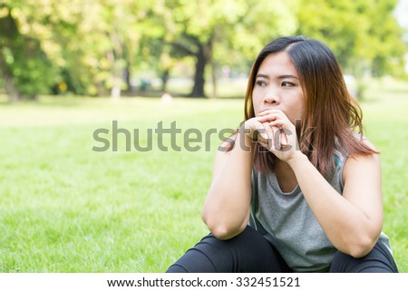 Asian women unhappy in the park