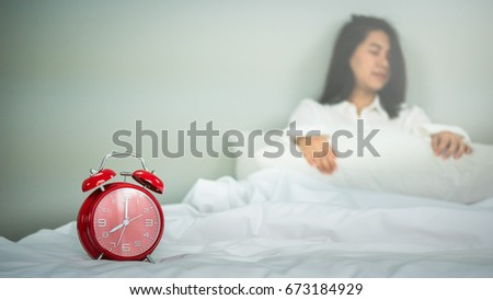 asian women wake up from sleep holding pillow on the bed in the morning on