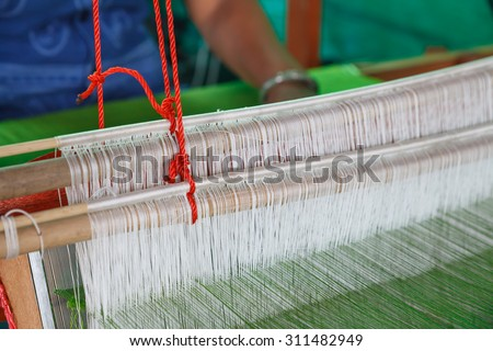 Asian women weave silk - stock photo