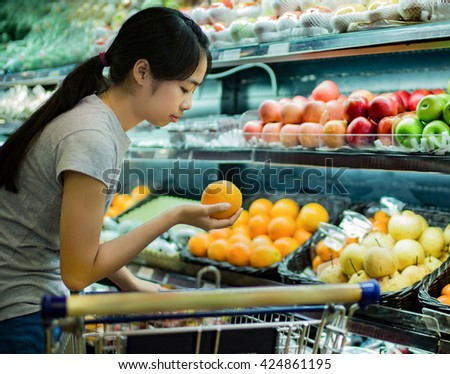 Asian women were shopping for fruit in supermarkets - stock photo