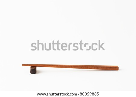 Asian wooden chopstick on white background.