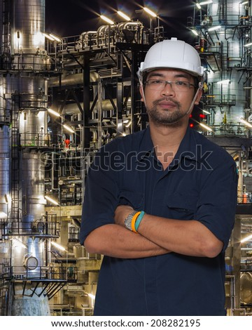 Asian worker with oil refinery plant and pipe line  - stock photo